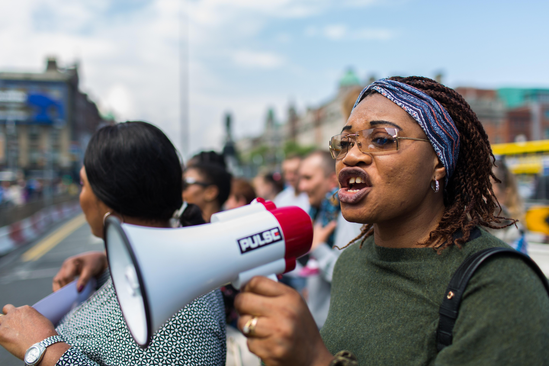 Woman shouting via megaphone