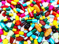 Many colorful pills, tablets and capsules medical drug. Concept of drug use and drug overdose.