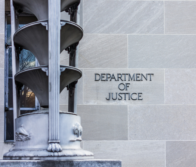 Department of Justice building with sign