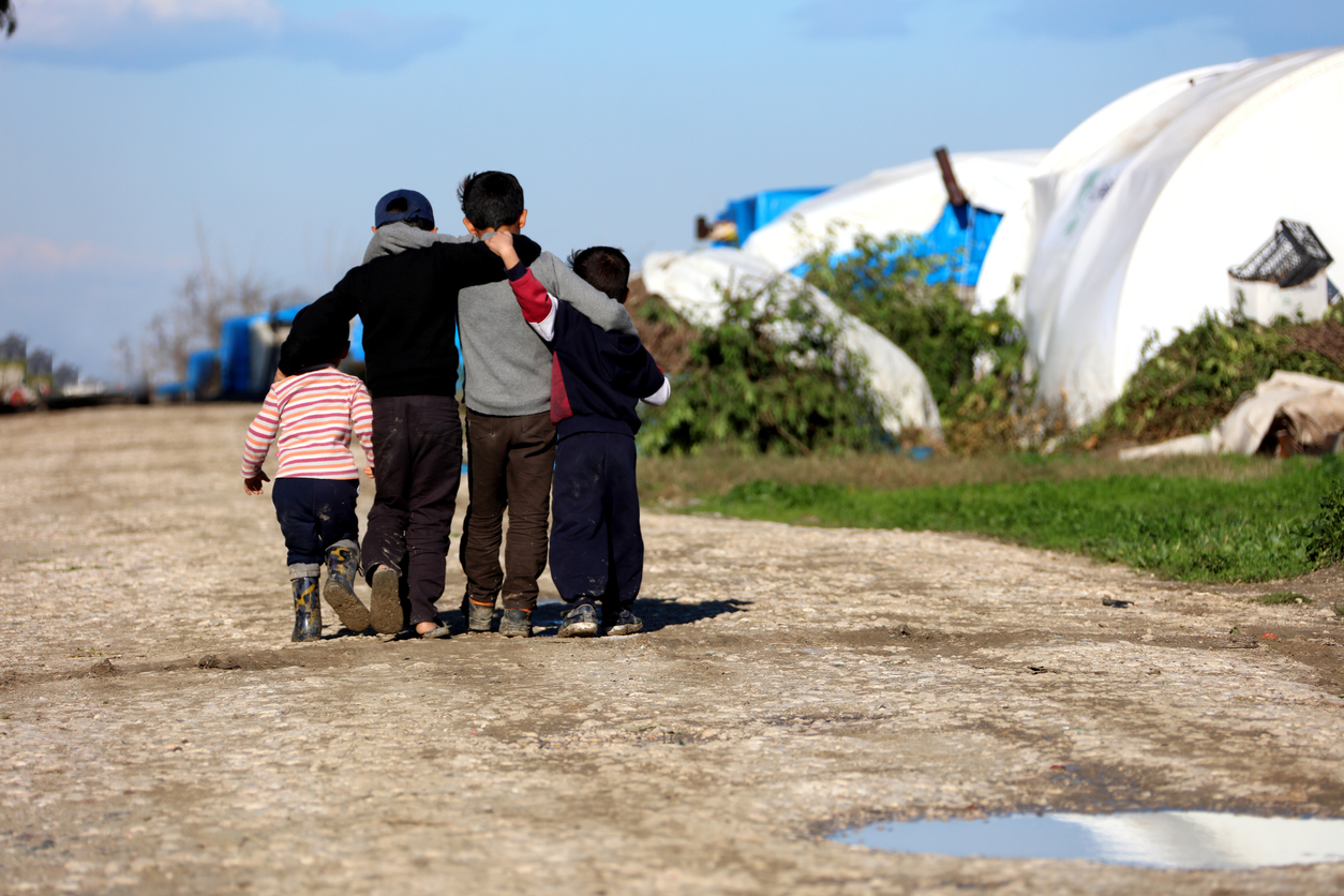 Syrian children hugging in the camp