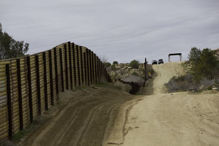 Border Patrol Vehicles Near Barrier Wall in California