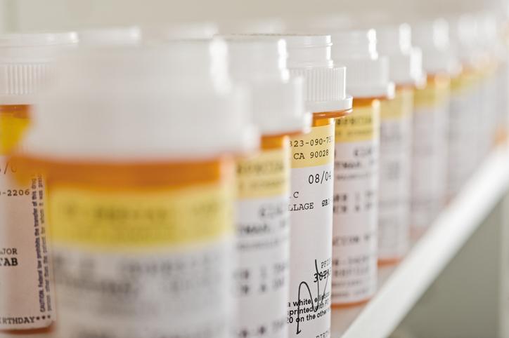 Medicine Bottles Arranged In Shelf