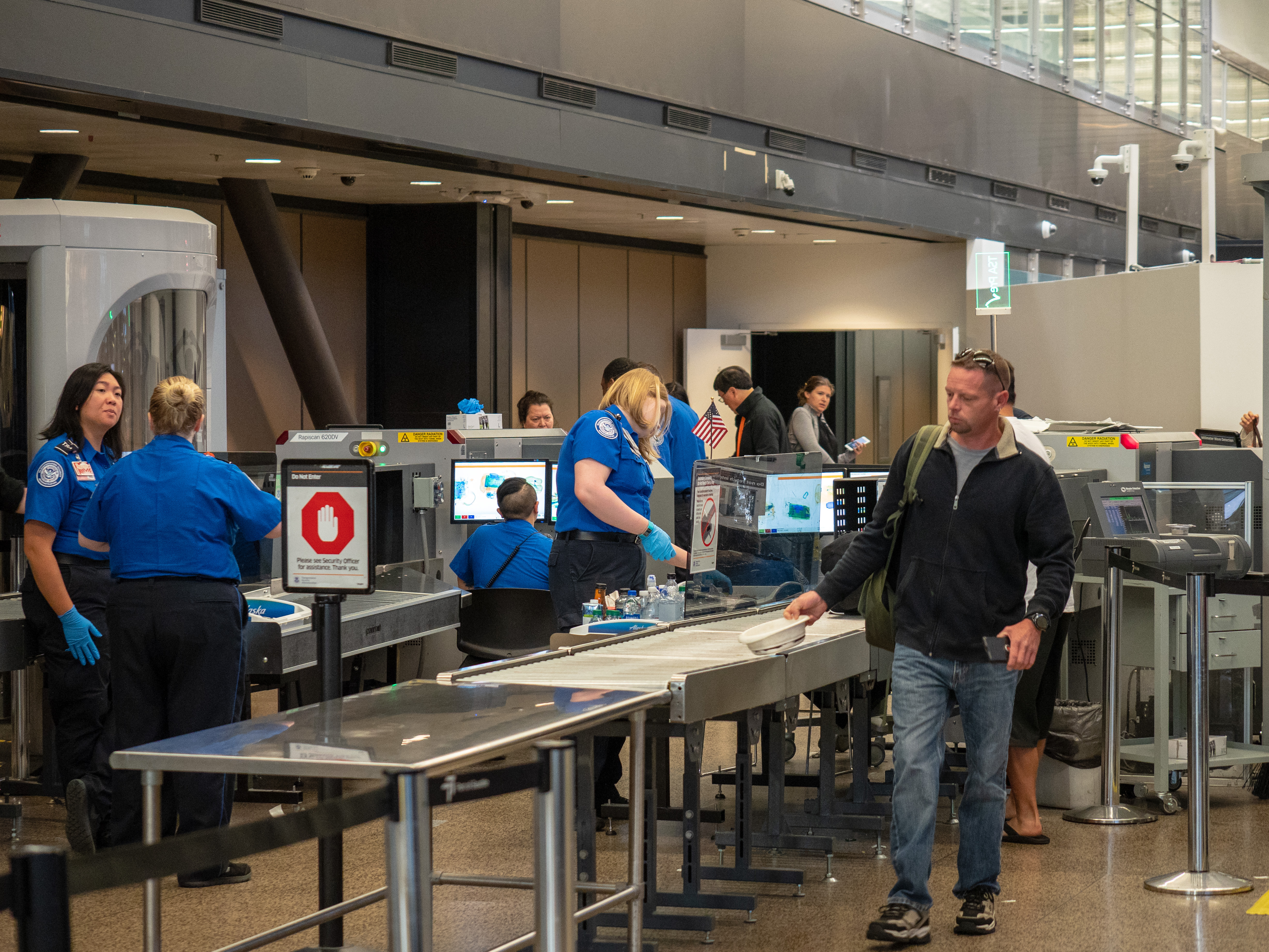 Man passes though Transportation Security Administration TSA security checkpoint at Seattle-Tacoma International Airport