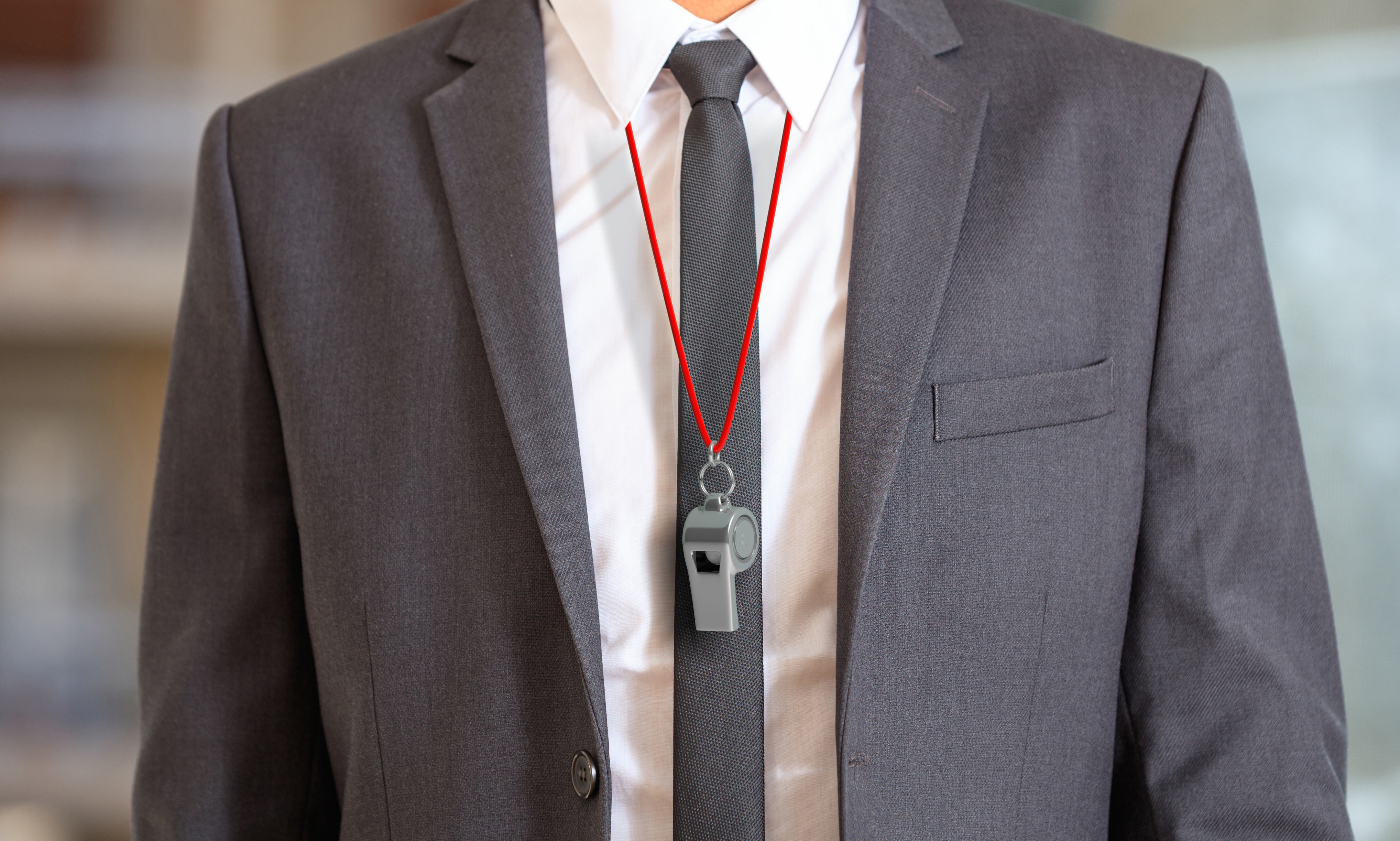 Man in suit wearing a whistle with red string. 3d illustration