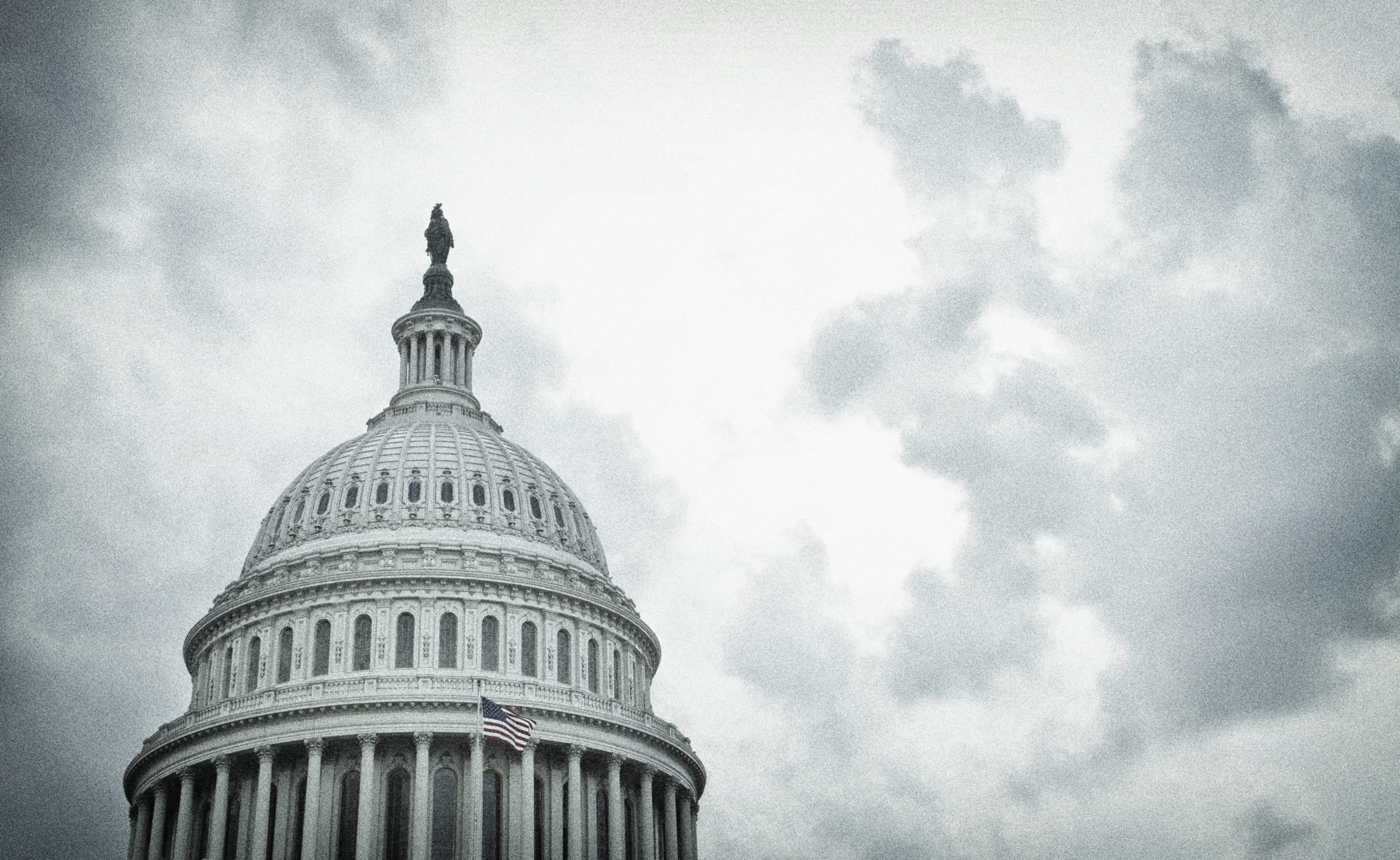 Textured image of the United States Capitol dome on cloudy day