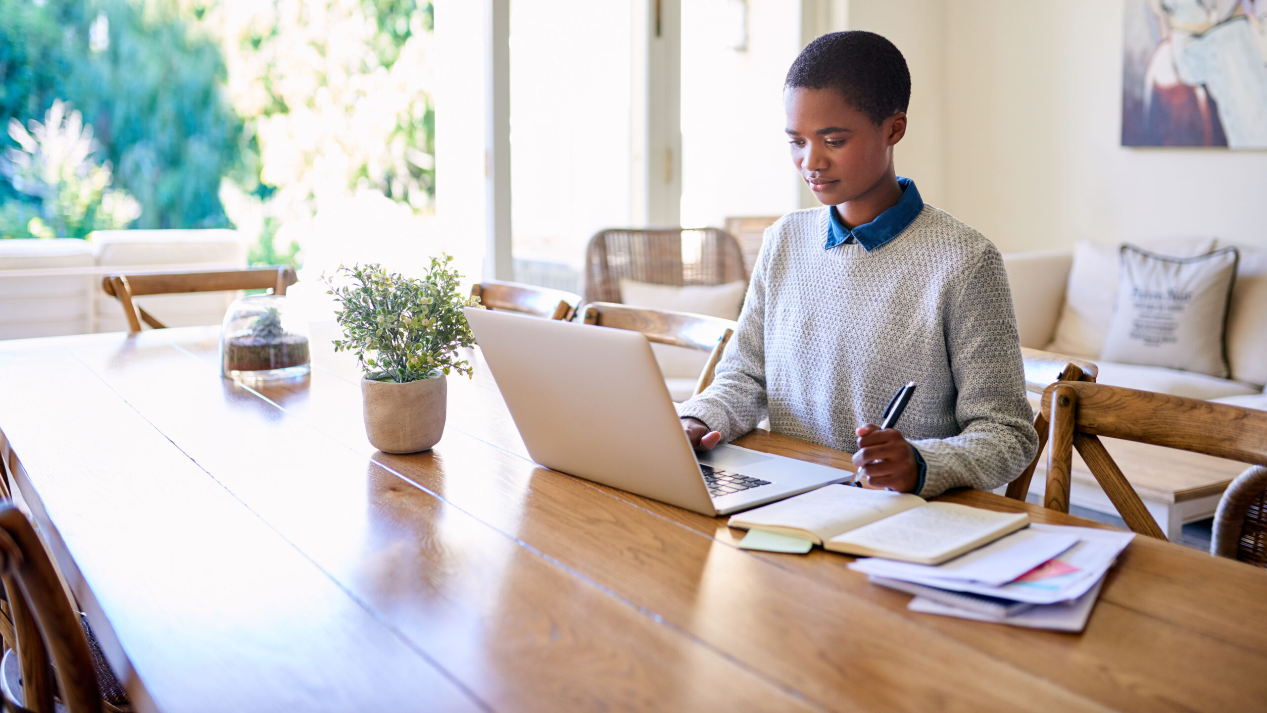 Focused young African American female entrepreneur working from home