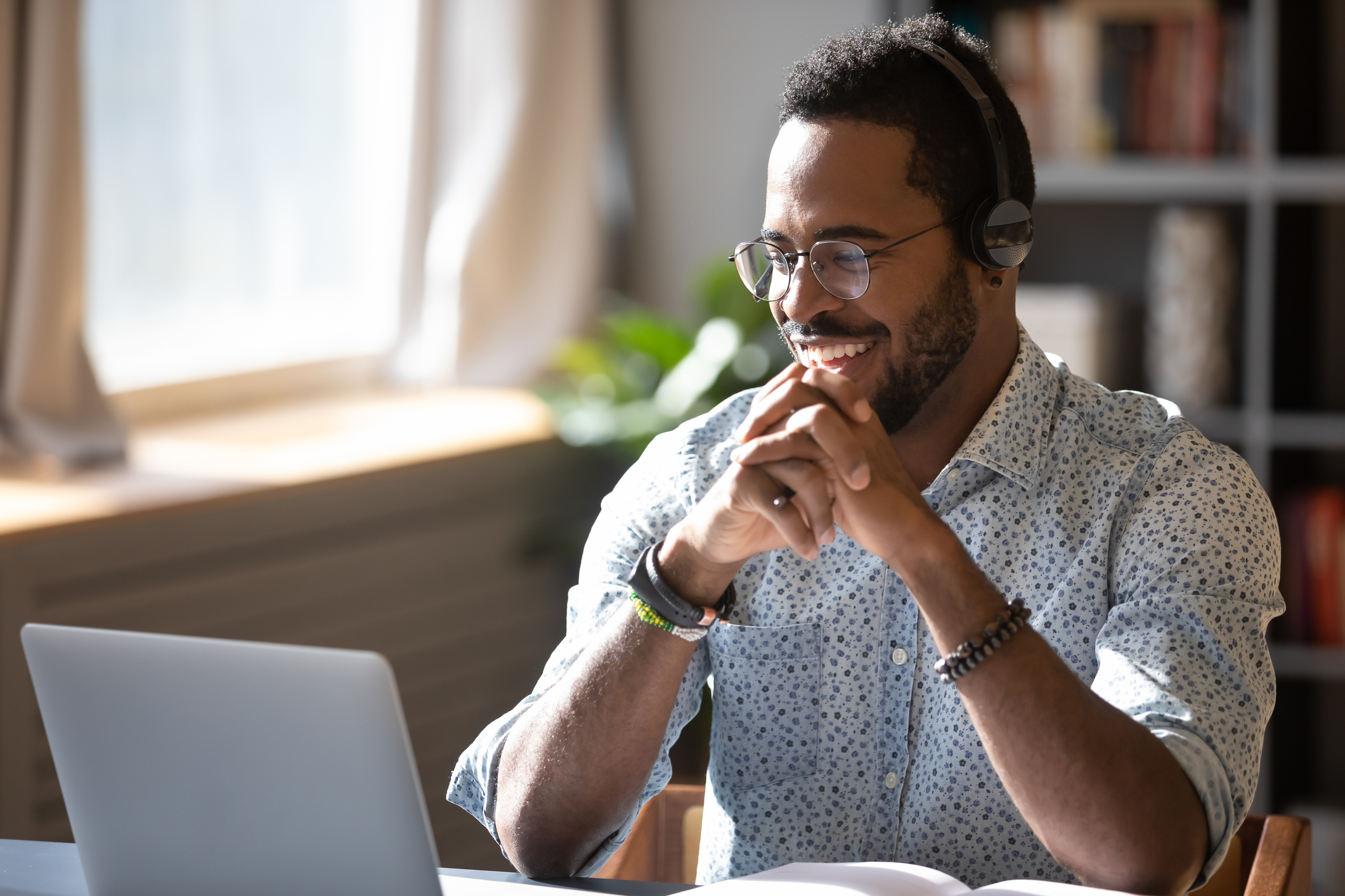 Man on video call smiles at his computer
