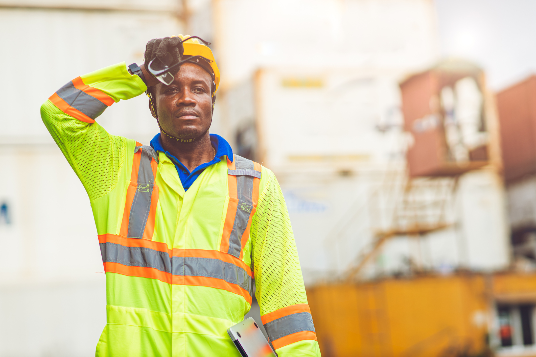 Construction worker, tired stressed worker sweating from hot weather in summer working in port goods cargo shipping logistic ground