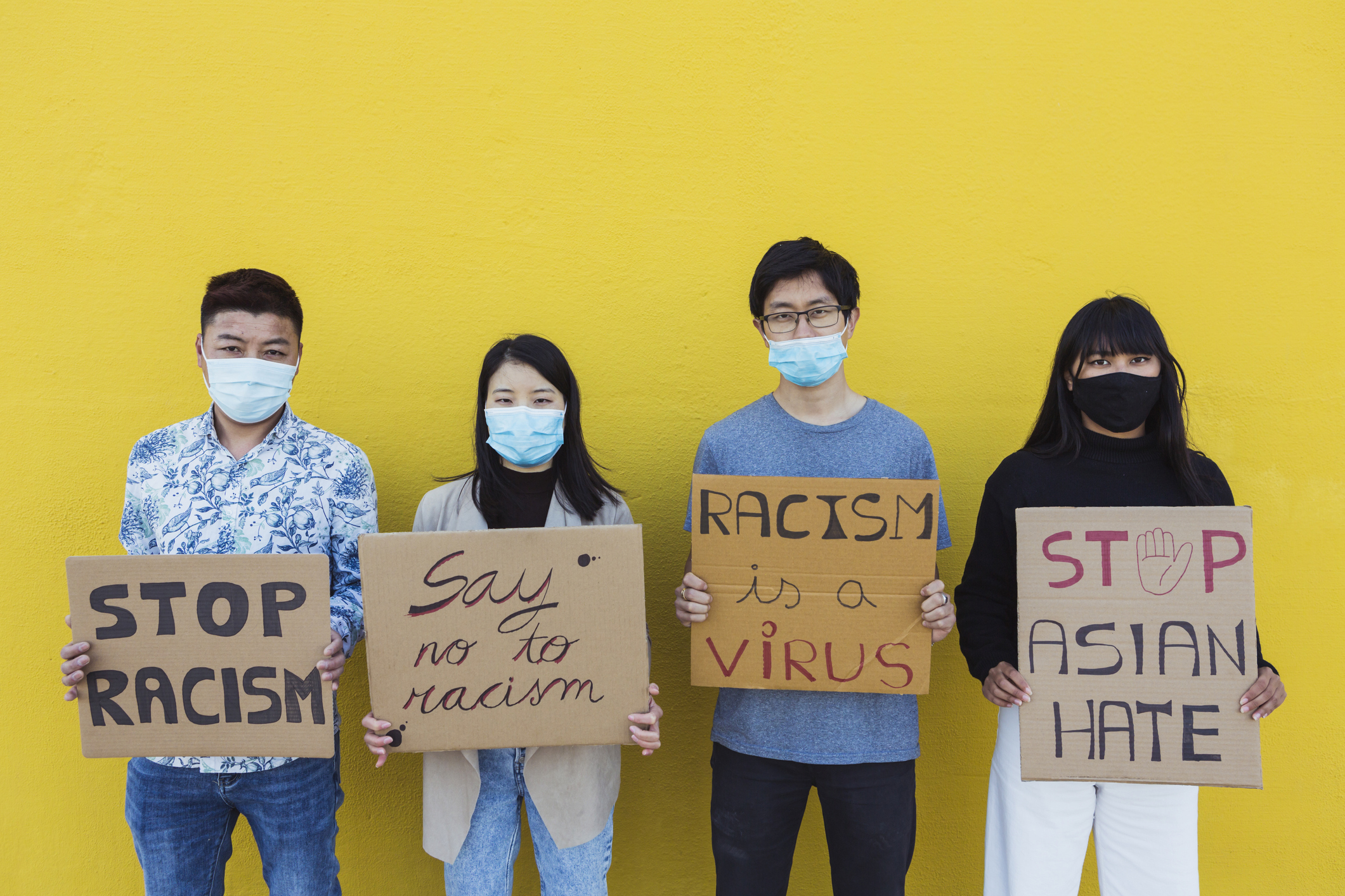 Group of Asian people protest on the street for equal rights